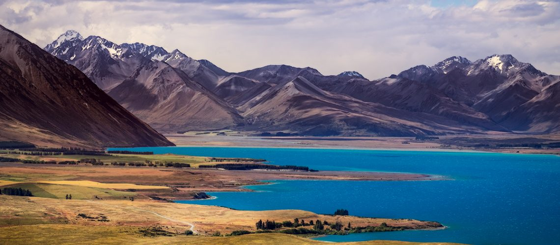 Landscape view of lakes and mountains, Lake Tekapo, Southern Alps, South island of New Zealand